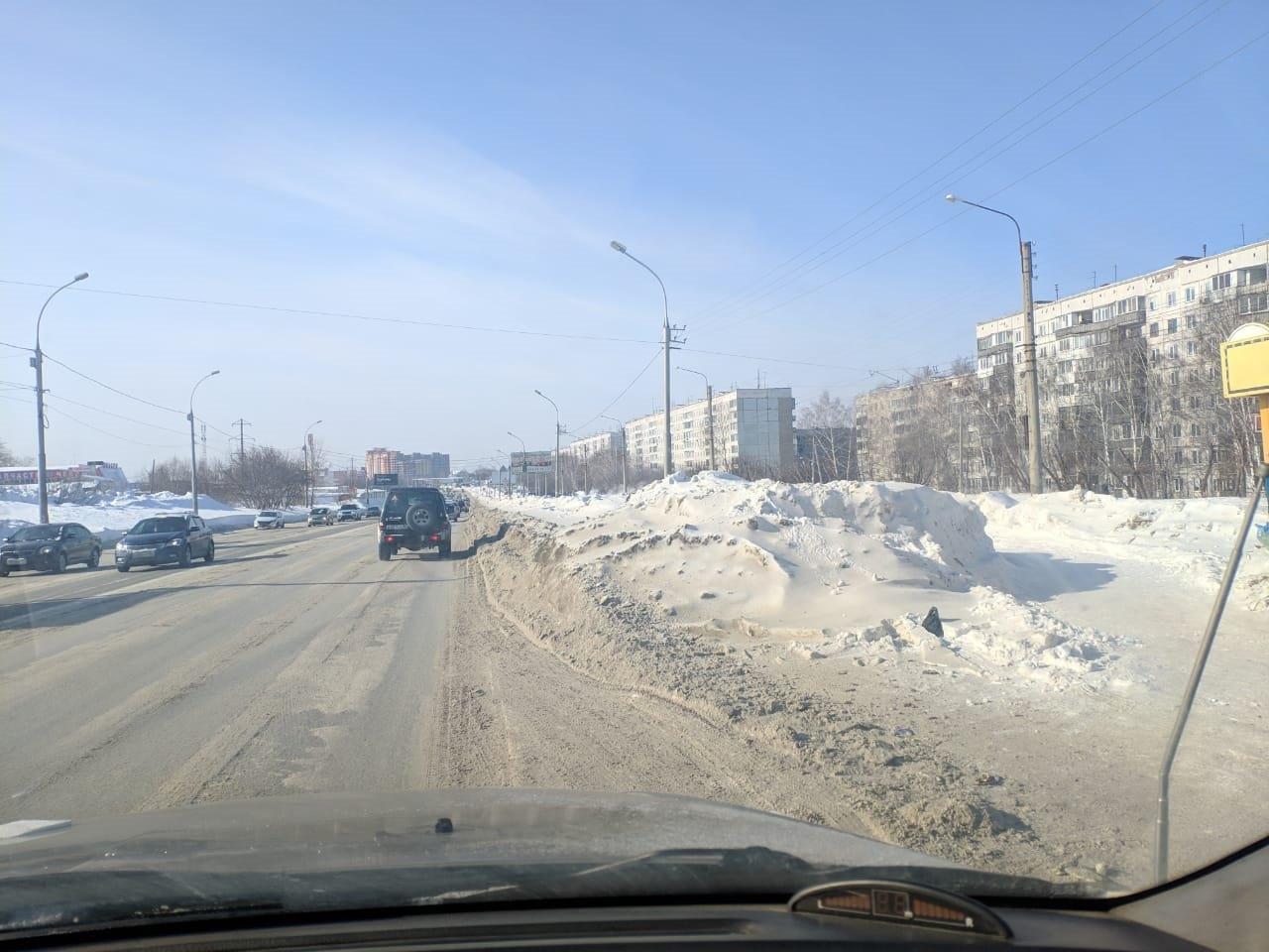 фото «Ждут, когда растает сам»: снег не вывозят с Гусинобродского шоссе всю зиму – горожанка рассказала о борьбе с сугробами 4