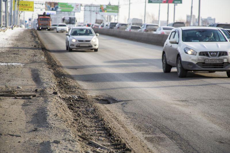 фото Прощай, подвеска: 10 фото убийственных ям на Октябрьском мосту в Новосибирске 2